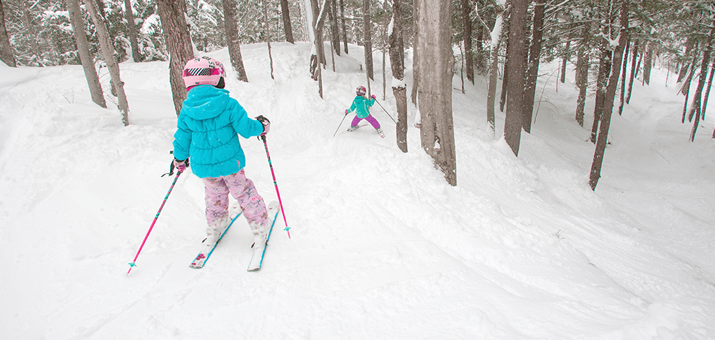 Kids skiing into the glades