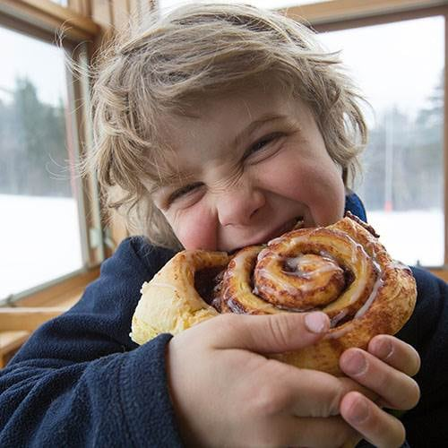 Eating cinnamon bun at North Peak.
